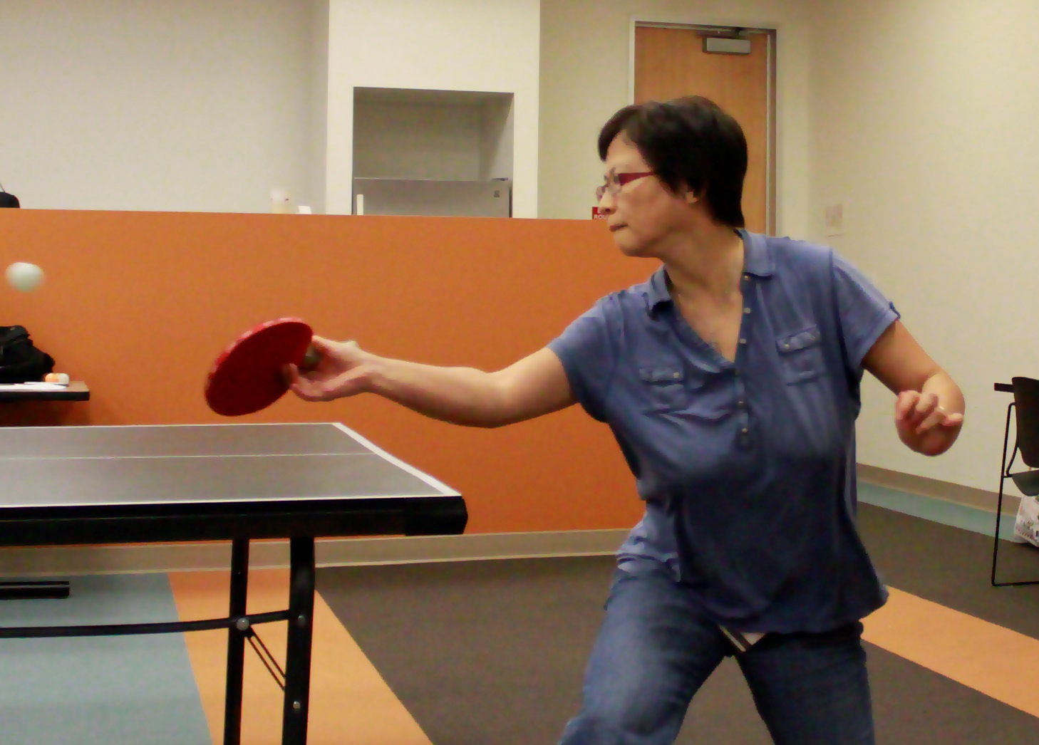 Technology Manager Tsing Xue's 'penhold' grip served her well at FindLaw's table tennis tournament last week. (Photo by FindLaw Software Development Engineer Anthony Hoang)